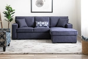 Blue two piece sectional sofa in living room.