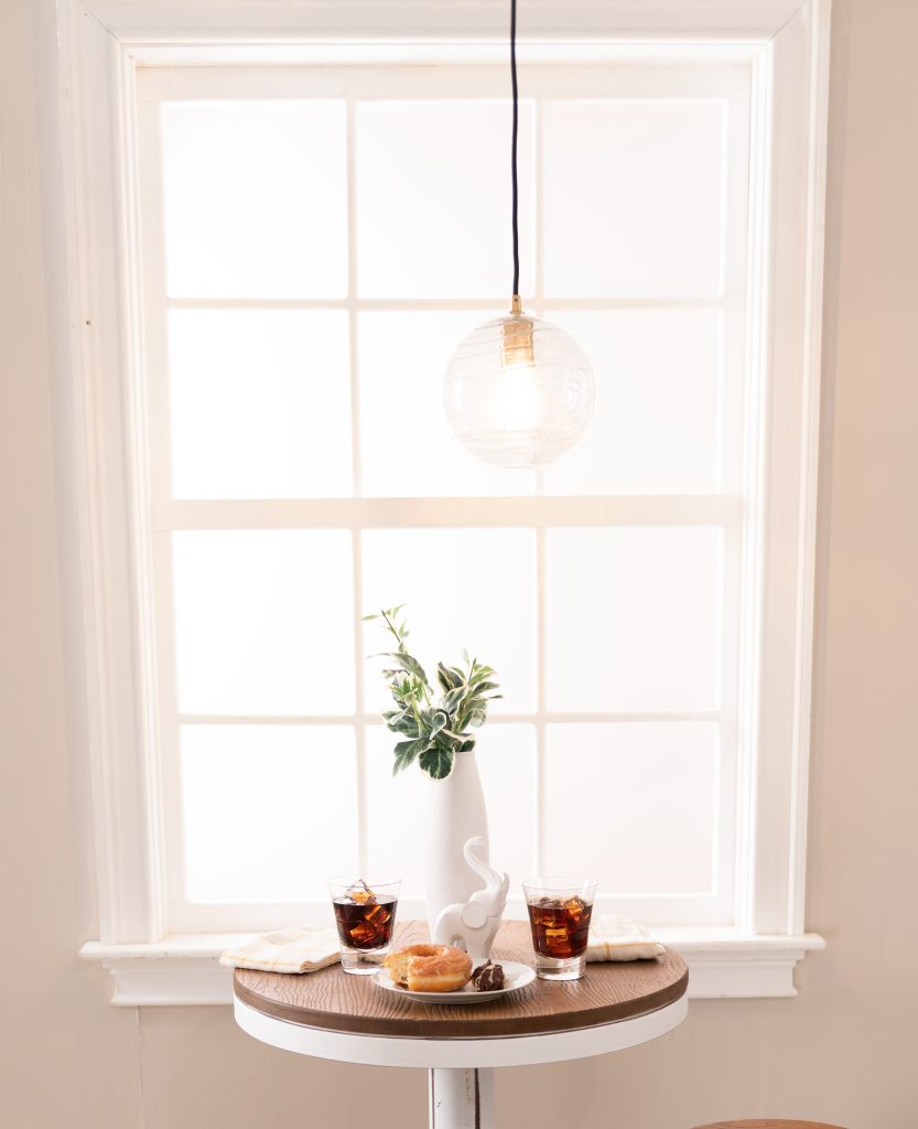 Try hanging a small pendant light above your small dining room table | Bob's Discount Furniture