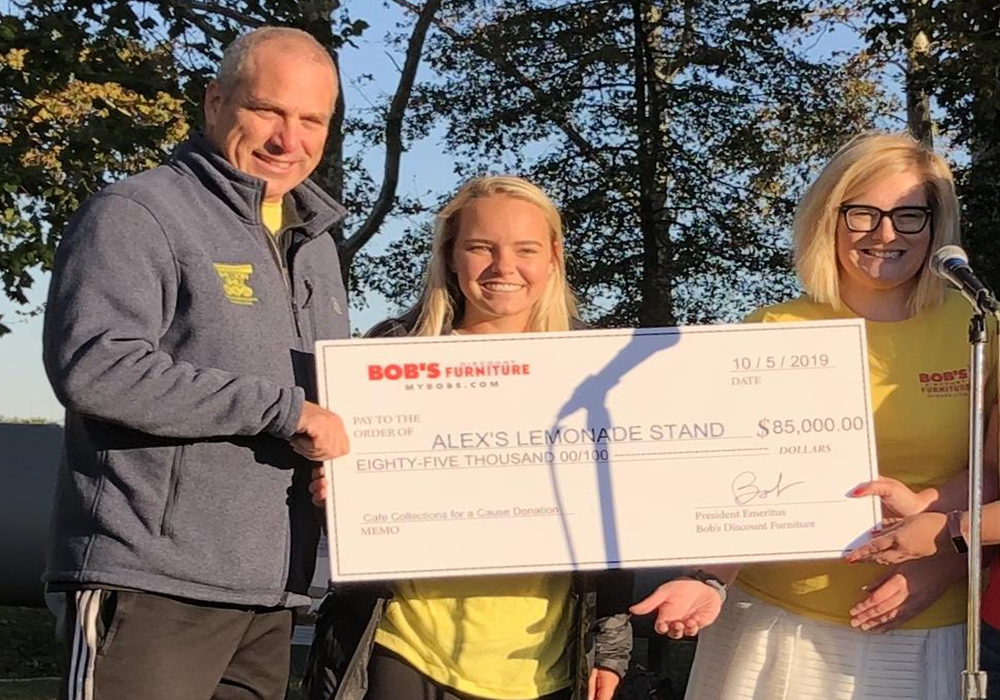 Becki Brown and Kasey McMahon present a check to ALSF's Jay Scott | Bob's Discount Furniture