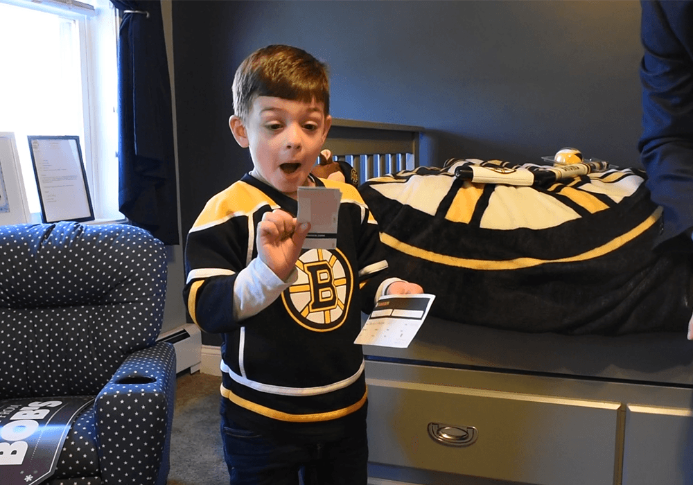 Grant reacts to receiving tickets to a Boston Bruins game.